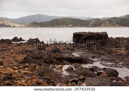 Stone coast of Pacific Ocean, New Zealand, Coromandel - stock photo