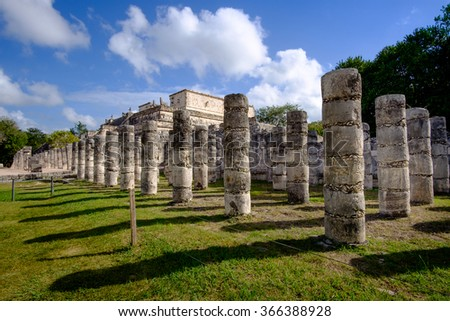 Stone columns and pilars in famous archeological site Chichen Itza, Mexico - stock photo