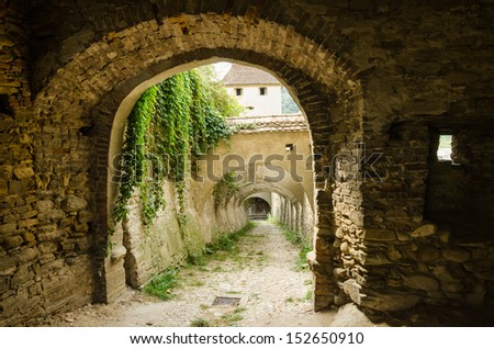 Stone Corridor To An Ancient Castle Dungeon - stock photo
