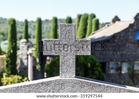 stone corss in Catalan cemetery, Cardedeu, Catalonia. - stock photo