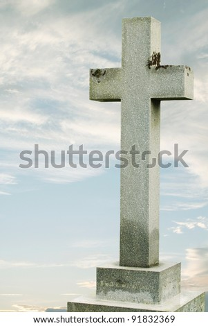 Stone Cross with Gentle Sky Background