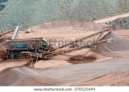 stone crusher in a quarry. mining industry. - stock photo