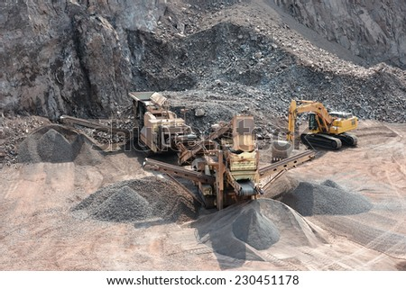 stone crusher in surface mine quarry - stock photo