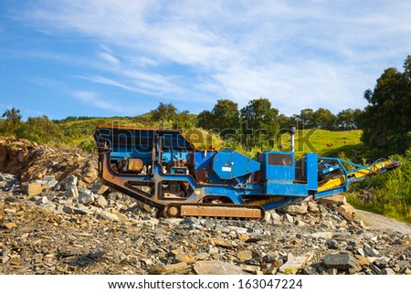 Stone crushers in the mountains at a quarry.