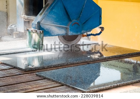 stone cutting closeup ,granite sawing machine in a factory   - stock photo