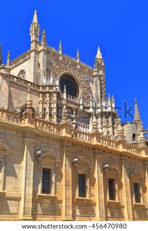 Stone decorations of the Gothic Cathedral of Saint Mary of the See (Seville Cathedral) in sunny day, Seville, Andalusia, Spain - stock photo
