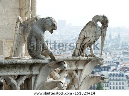 Stone demons gargoyle and chimera with city of Paris on background. View from the tower of the Notre Dame - stock photo