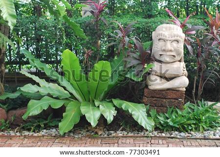 Stone Doll Maya Garden Statue - stock photo
