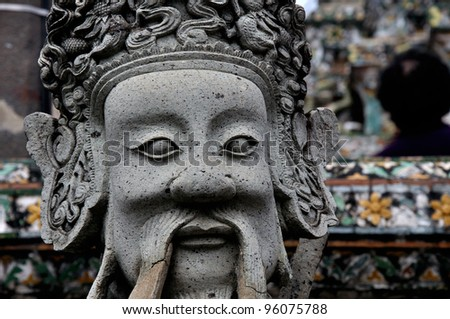 Stone dolls in wat Arun,Bangkok,Thailand. - stock photo