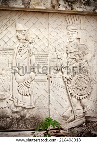 Stone door decorated with ancient mayan sculptures - stock photo