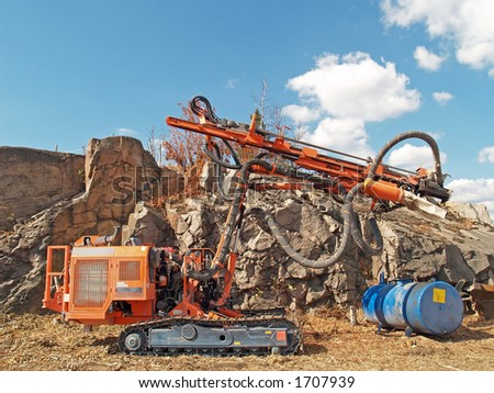 Stone drilling tractor at noon - stock photo