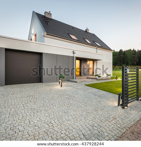 Modern house stock images royalty free images vectors for Stone garage designs