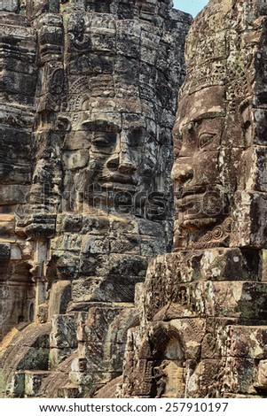 Stone faces of The Bayon, part of the temple complex of Angkor in western Cambodia