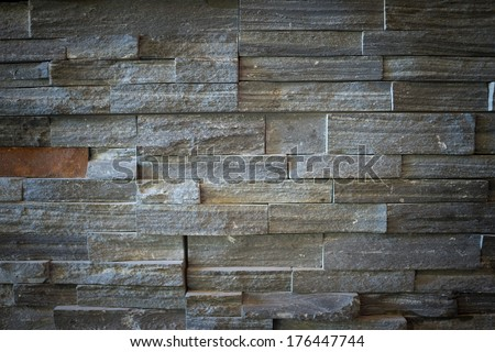 Stone feature wall with vignetting suitable as a background or texture.