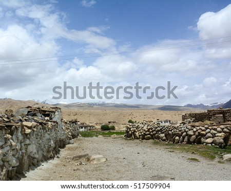 Stone fence at the Tibetan village in Leh, Ladakh, India. Ladakh is one of the most sparsely populated regions in Jammu and Kashmir.