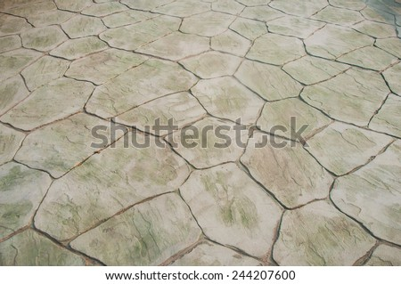 Stone floor pattern with a crack - stock photo