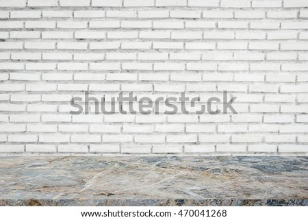 Stone floor with old brick wall for background.