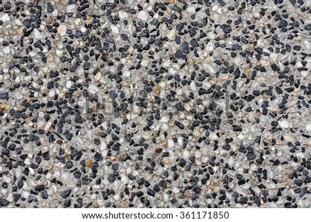 stone foot path made from small stones and concrete - stock photo