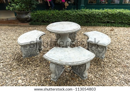 Stone Garden Table and four chairs.
