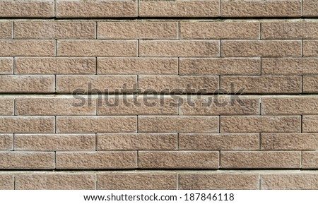 Stone granite wall of building for background and texture