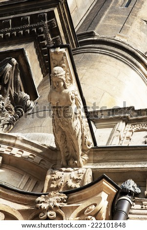 Stone grotesque  female-gargulya in a cathedral - stock photo
