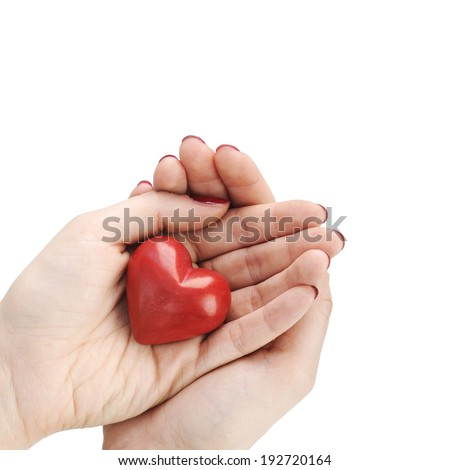 stone heart in hands - stock photo