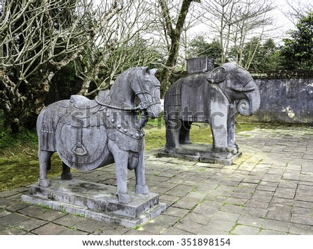 Stone horse and elephant in emperors burial place memorial garden; Vietnam