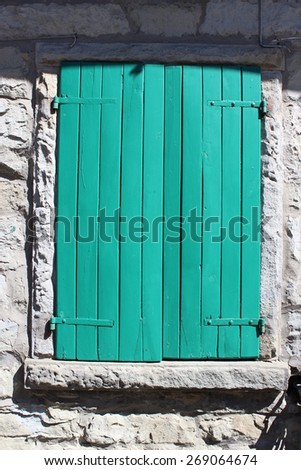 Stone house green wooden window - stock photo