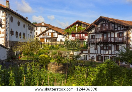 Stone houses and ornate wood very typical in the beautiful village of Etxalar, Spain - stock photo