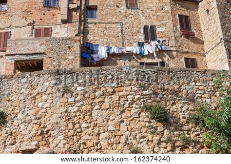 Stone houses of Pienza overlooking the countryside of Italy - stock photo