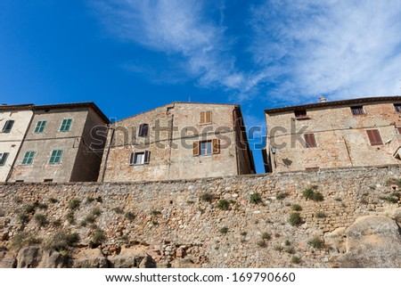 Stone houses of Pienza overlooking the countryside of Tuscany - stock photo