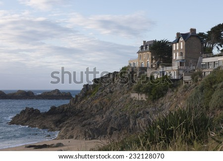 Stone houses on cliffs in Saint-Malo - Plage du Val, Saint-Malo, Brittany, France - stock photo