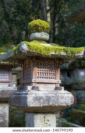 Stone lanterns on the road leading to Kasuga shrine in Nara, Japan - stock photo