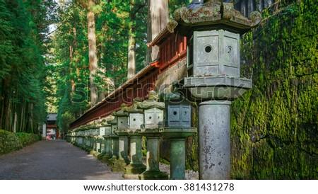Stone Lanterns on the Side of Toshogu Shrine in Nikko, Tochigi, Japan  - stock photo