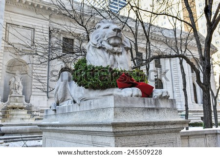 Stone lion at the entrance to the New York Public Library Main Branch in Midtown, Manhattan, New York. - stock photo