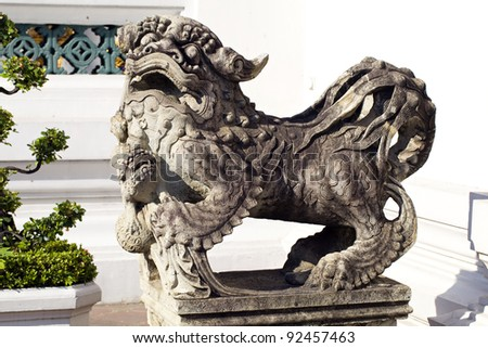 stone lion sculpture at Grand Palace, Thailand