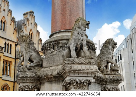 Stone lions monument of the War Memorial in front of Westminster Abbey in London - stock photo