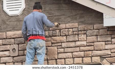 Stone Mason Working 1 - stock photo