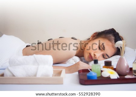 Stone Massage. Beautiful Woman Getting Spa Hot Stones Massage in  Thai Spa Salon.