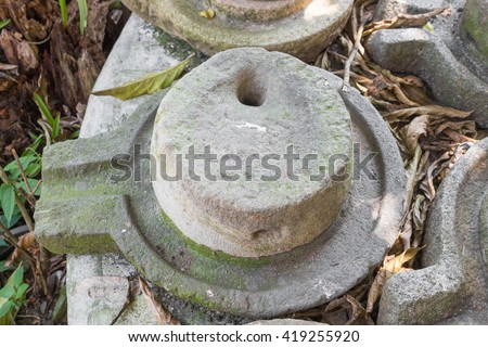 Stone mill,ancient Flour Mill,old marble hand mill.(select focus front stone mill) - stock photo