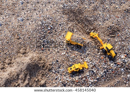 stone mining. toy excavator, truck and loader in a quarry. top view.  empty space for your text - stock photo