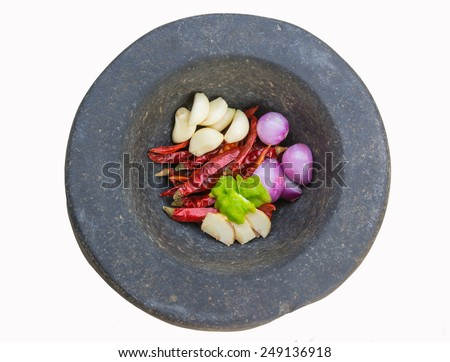 stone mortar and pestle, thai ingredients, galangal, lime, lemongrass, chilli, garlic and lime - stock photo