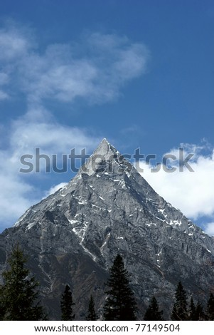 Stone mountain with blue sky - stock photo