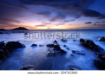 Stone on sea with a beautiful sunset in nature, eastern in Thailand - stock photo