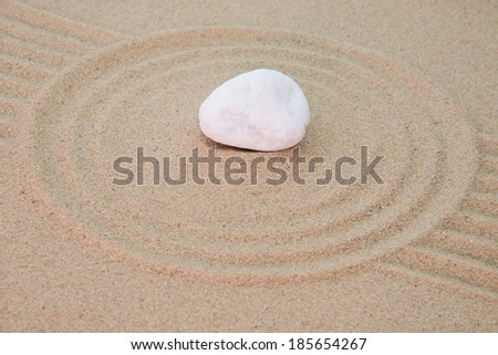 stone onto sand with patterns