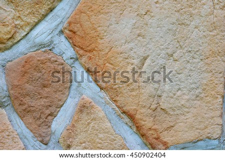stone or rock wall background texture with mortar cracks - stock photo