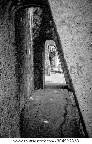 stone passage in tunnel form, sirmione, italy - stock photo