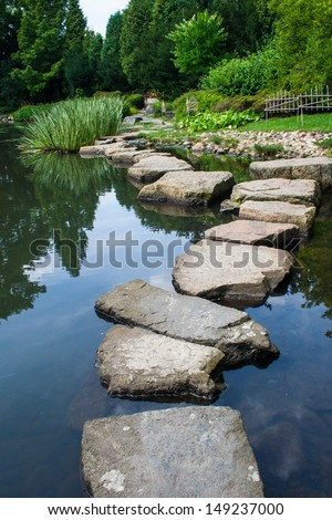 Stone path in japanese garden - stock photo