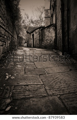 Stone Path Leading up a Dark Alleyway - stock photo