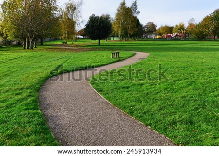 Stone Path through a Peaceful Green Park - stock photo